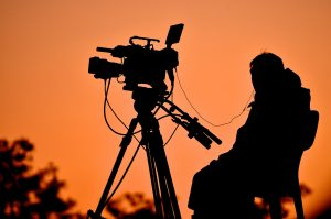 Silhouette of a TV cameraman