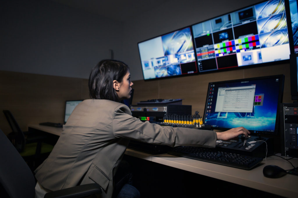 A television editor working with vision mixer - Getty Images photo